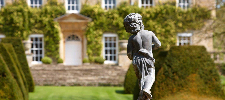 cornwell-manor-facade-statue