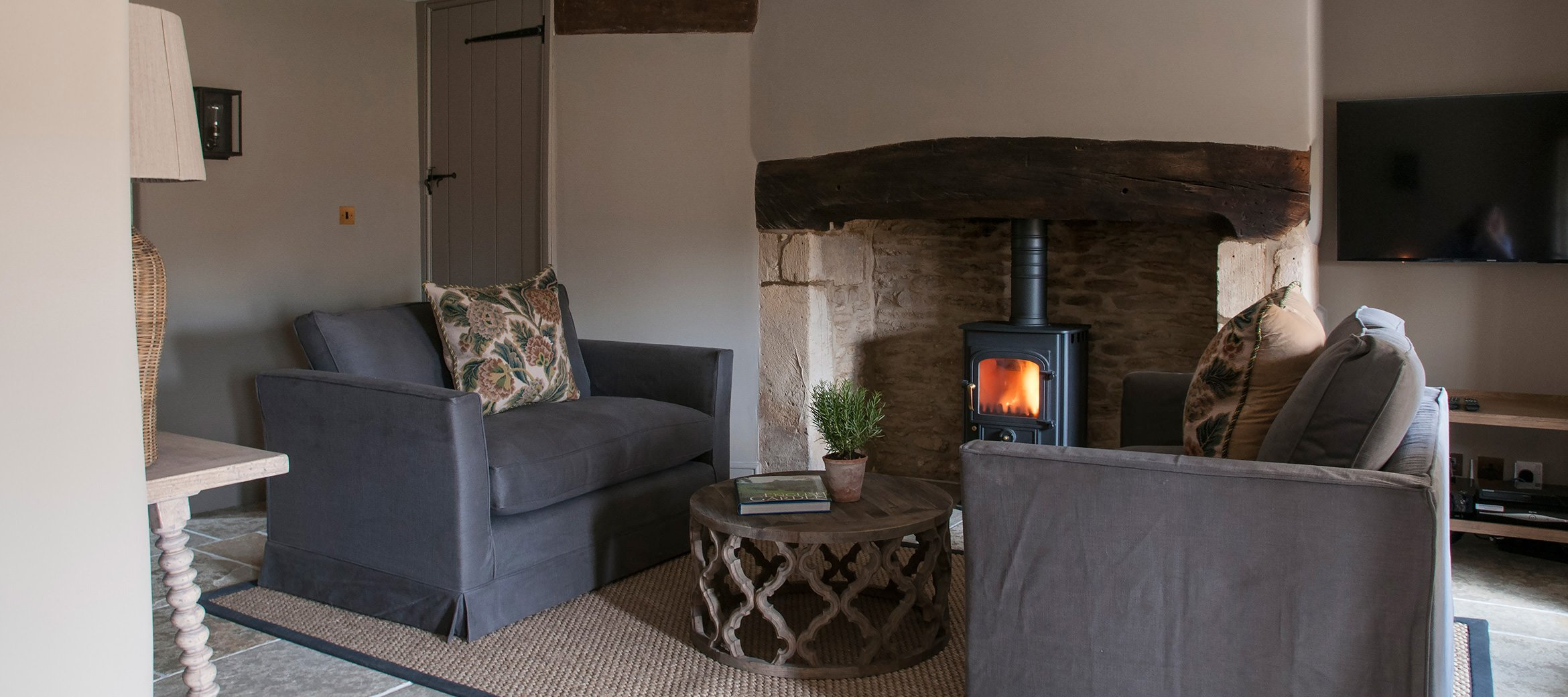 dovecote-luxury-cotswold-cottage-sitting-room-woodburner
