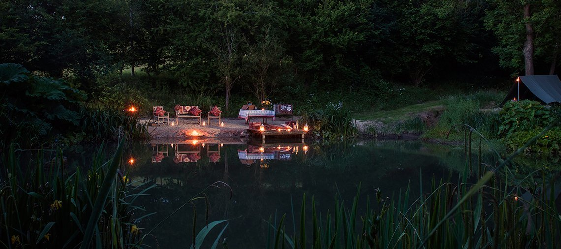 dryhill-cotswold-wild-water-swimming-pools-dusk